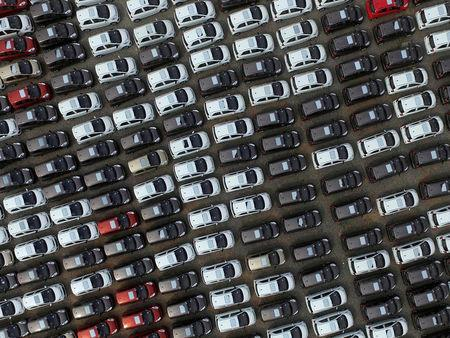 FILE PHOTO: Electric cars are seen at a parking lot of an automobile factory in Xingtai, Hebei province, China