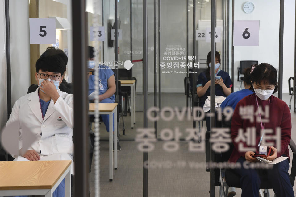 Medical workers wait to receive the first dose of the Pfizer BioNTech COVID-19 vaccine at the National Medical Center vaccination center in Seoul Saturday, Feb. 27, 2021. (Song Kyung-Seok/Pool Photo via AP)