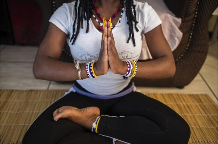 Yoga teacher Siri Ajeet Dipuo Banda enjoys her morning routine at home in Alexandra district, South Africa, on Wednesday.