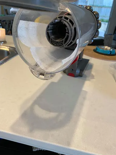 The hack was shared by a mum who said she put a Fluffy dryer sheet into the barrel of her Dyson vacuum. Photo: Facebook