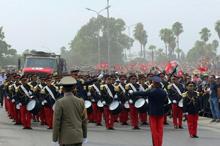 Members of the military marching band escort the coffin of late president Beji Caid Essebsi to his last resting place at the Djellaz cemetery in Tunis (AFP Photo/Anis MILI)