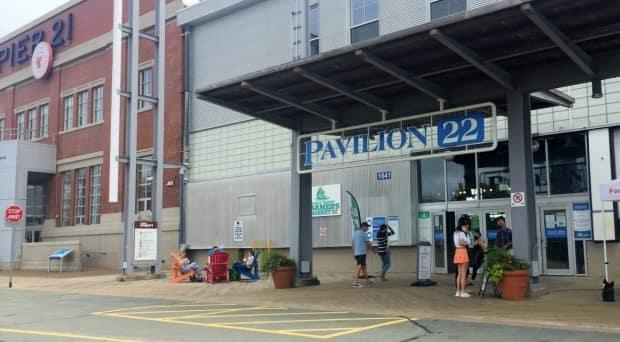 People shown entering the Seaport Farmers' Market in Halifax on June 27, 2021. The market is now open all weekend for the first time since the third wave of the pandemic hit Nova Scotia. (Haley Ryan/CBC - image credit)
