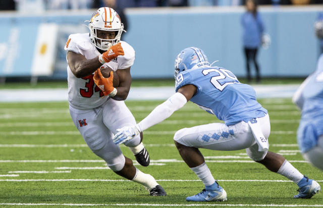 Mercer's Tyray Devezin (34) carries the ball as North Carolina's Storm Duck (29) attempts a tackle during the first half of an NCAA college football game in Chapel Hill, N.C., Saturday, Nov. 23, 2019. (AP Photo/Ben McKeown)