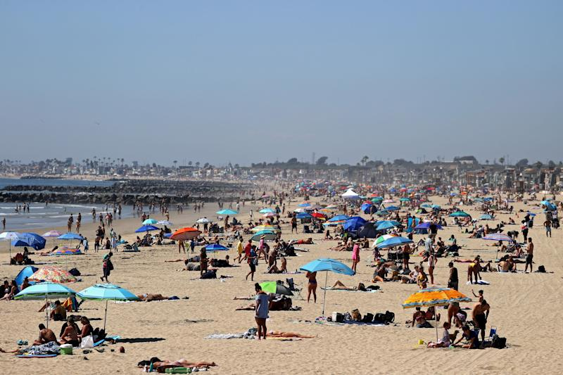 Crowds filled beaches in Newport Beach, California, last weekend as temperatures rose in Southern California. Many California counties have closed beach access. (Michael Heiman via Getty Images)