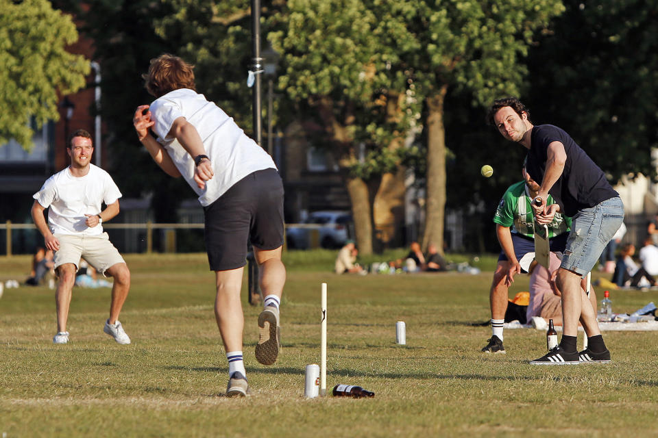 A group of boys play cricket on Clapham Common, London, on Bank Holiday Monday after the introduction of measures to bring the country out of lockdown due to the coronavirus pandemic.