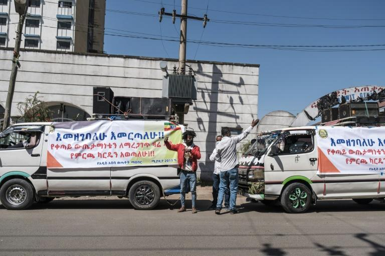 Vans promoting voter registration on the streets of Addis Ababa