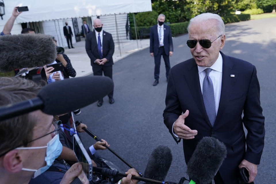 President Joe Biden talks with reporters before boarding Marine One on the South Lawn of the White House in Washington, Friday, July 30, 2021, as he heads Camp David for the weekend. (AP Photo/Susan Walsh)