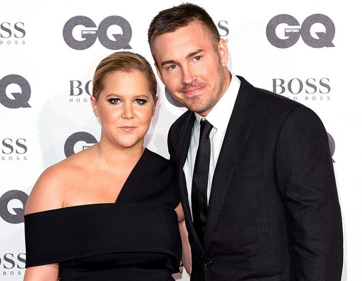 Amy Schumer has nothing to hide when it comes to her relationship with Ben Hanisch. (Photo: Jeff Spicer/Getty Images)