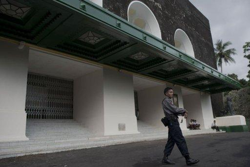 A police officer is seen securing the front entrance of Yangon University's Convocation Hall, where US President Barack Obama is anticipated to deliver a lecture on his historic visit in Yangon. The Obama administration said that the world's largest economy would open up to products from the long-isolated nation formerly known as Burma with the exception of gems