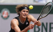 Germany's Alexander Zverev plays a return to Russia's Roman Safiullin during their second round match on day four of the French Open tennis tournament at Roland Garros in Paris, France, Wednesday, June 2, 2021. (AP Photo/Michel Euler)