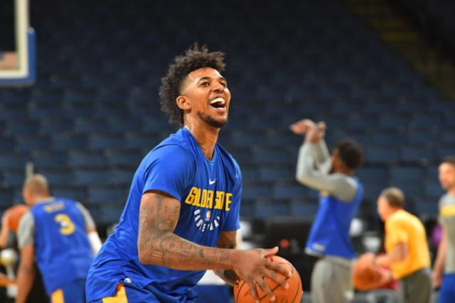 """<a class=""""link rapid-noclick-resp"""" href=""""/nba/teams/gsw"""" data-ylk=""""slk:Golden State Warriors"""">Golden State Warriors</a> guard <a class=""""link rapid-noclick-resp"""" href=""""/nba/players/4294/"""" data-ylk=""""slk:Nick Young"""">Nick Young</a> got a new neck tattoo in Cleveland less than 24 hours before Game 3 of the NBA Finals on Wednesday night. (Getty Images)"""