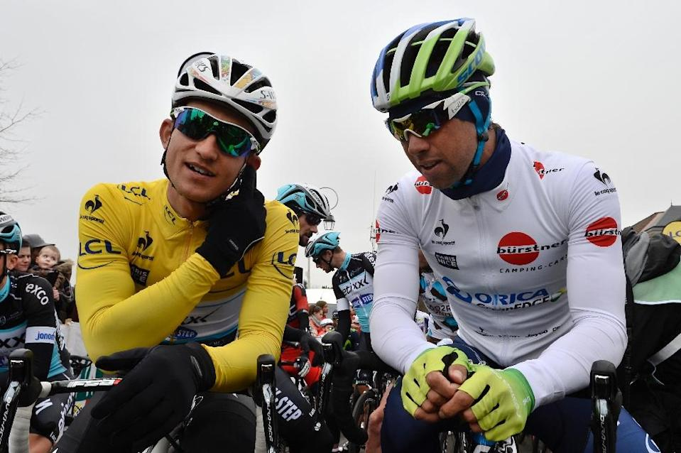 Poland's Michal Kwiatkowski (L) speaks with Australia's Michael Matthews ahead of the first stage of the 73rd edition of the Paris-Nice cycling race, in March 2015 (AFP Photo/Lionel Bonaventure)