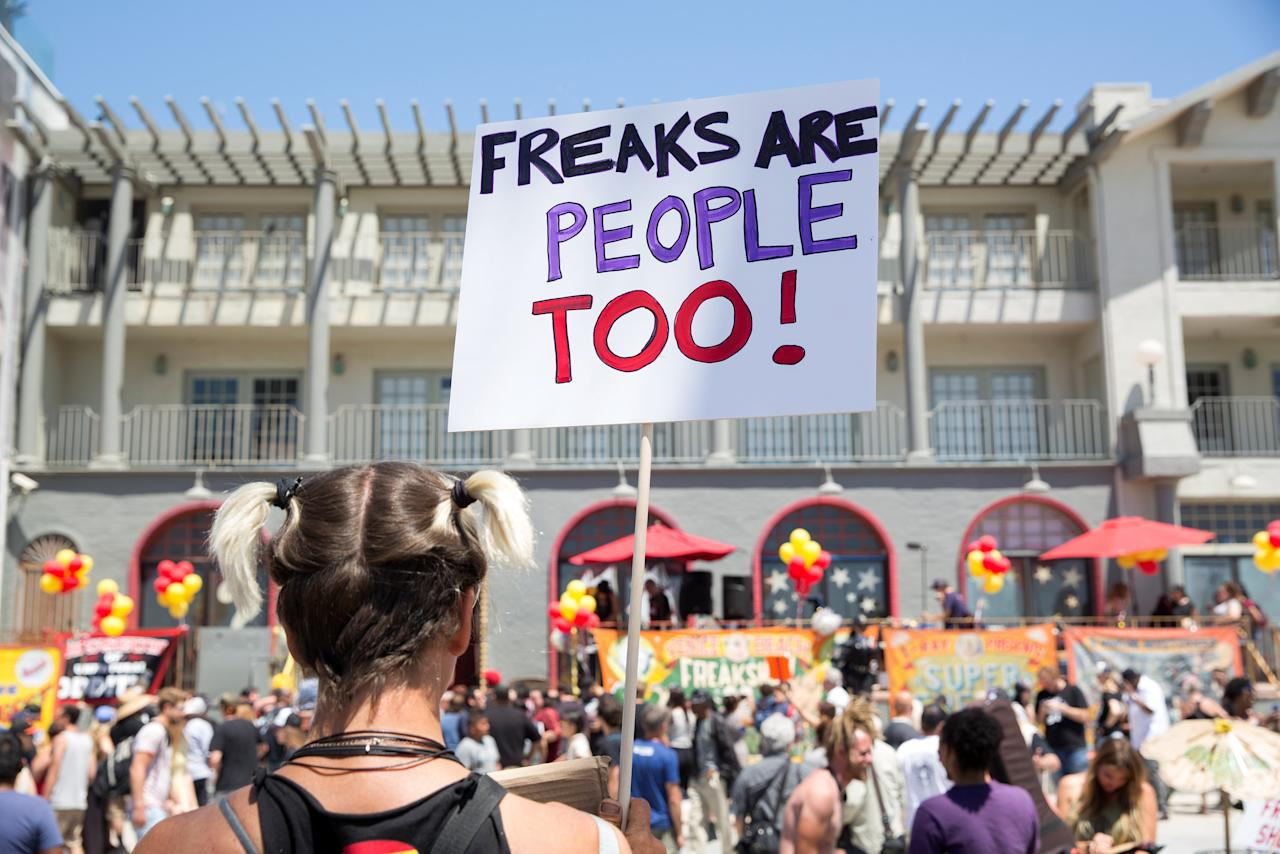 A supporter of the Venice Beach Freak Show holds a sign during the show's final performance and rent rise protest party on Venice Beach, Los Angeles, California, U.S., April 30, 2017. REUTERS/Monica Almeida
