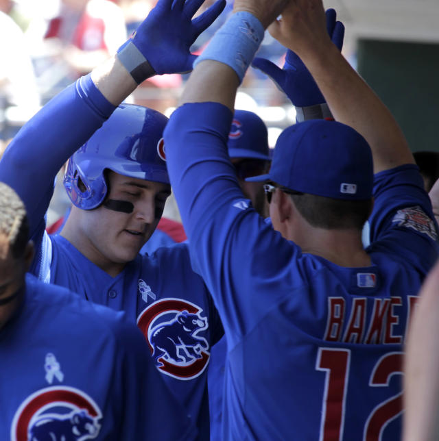 Chicago Cubs' Anthony Rizzo, left, celebrates with teammate John Baker (12) after hitting a solo home run against the Philadelphia Phillies in the first inning of a baseball game on Sunday, June 15, 2014, in Philadelphia. (AP Photo/H. Rumph Jr)