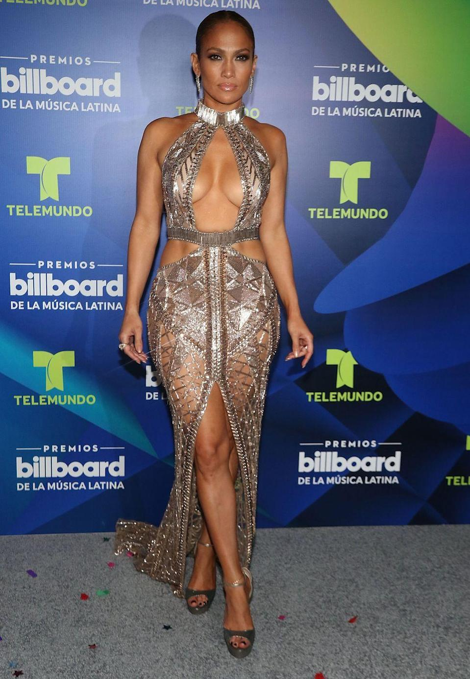 <p>J.Lo shows off her abs (a recurring theme in this gallery) at the Billboard Latin Music Awards in Coral Gables, Florida. At the event, she picked up awards for Social Artist of the Year and Female Hot Latin Songs Artist of the Year. Here, she wears a plunging bejeweled dress, silver heels, and a slicked-back ponytail.</p>