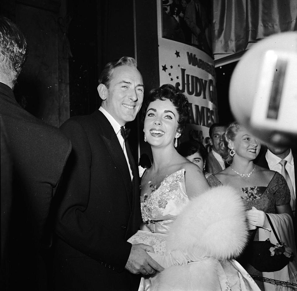 <p>Actress Elizabeth Taylor with husband Michael Wilding smile for the cameras as they show their support at the premiere of <em>A Star Is Born</em> in 1954. Star Judy Garland earned a Best Actress Oscar nomination for her role in the film but was absent at the awards ceremony as she was at the hospital giving birth to her son Joey. A television crew was even sent to the hospital to capture Garland's speech just in case she won, but the gold that year went to Grace Kelly for her role in <em>The Country Girl</em>.</p>