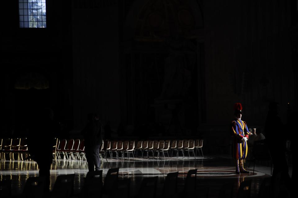A Swiss Guard stands attention prior to a Holy Thursday Mass with blessing of oils, in St. Peter's Basilica, at the Vatican,Thursday, April 18, 2019. (AP Photo/Alessandra Tarantino)