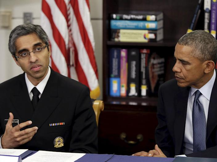Vivek Murthy, then the surgeon general, with then-President Barack Obama.