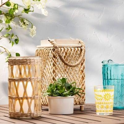 <p>This <span>Bamboo and Straw Outdoor Lantern with Glass</span> ($10) will be a welcome addition to your outdoor space.</p>