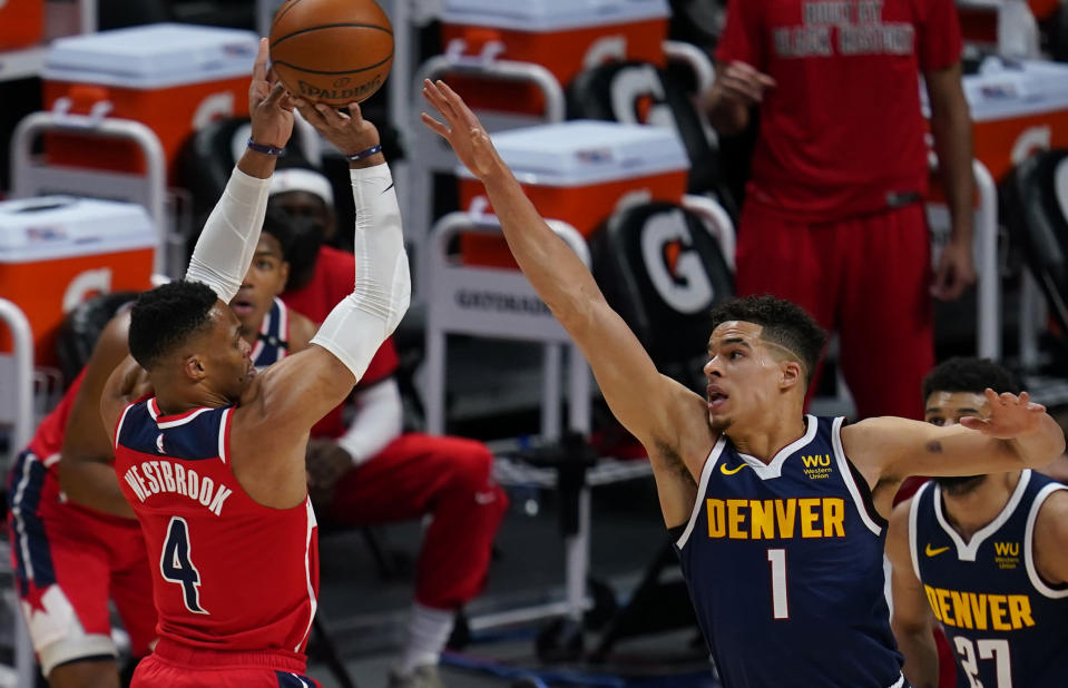 Washington Wizards guard Russell Westbrook (4) shoots against Denver Nuggets forward Michael Porter Jr. (1) during the first quarter of an NBA basketball game Thursday, Feb. 25, 2021, in Denver. (AP Photo/Jack Dempsey)