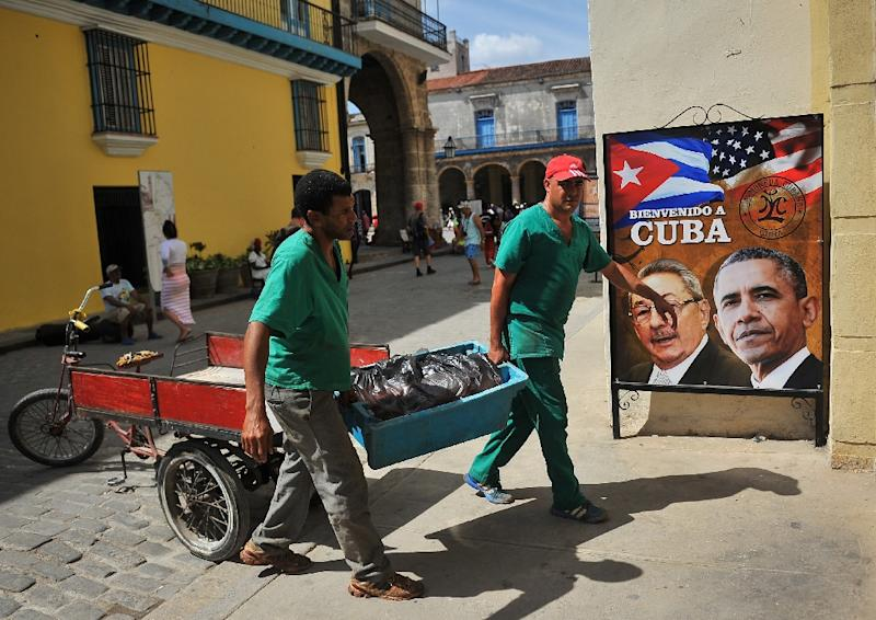 A poster of Cuban President Raul Castro and US President Barack Obama is seen in the entrance of the private restaurant La Moneda Cubana in Havana on March 17, 2016