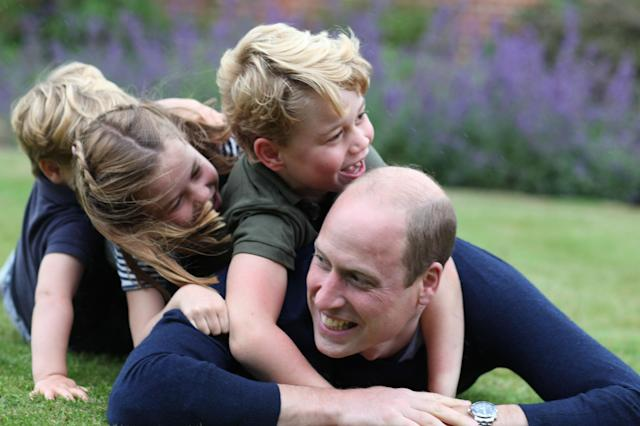 George, Charlotte and Louis appear to bundle their father in the new image shared for the duke's birthday. (The Duchess of Cambridge)