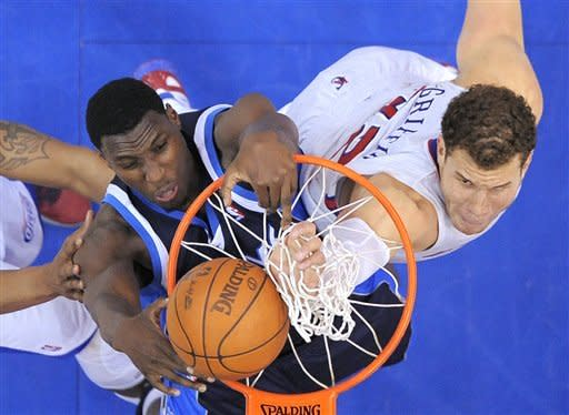 Los Angeles Clippers forward Blake Griffin, right, tries to block the shot of Dallas Mavericks center Ian Mahinmi of France during the second half of their NBA basketball game, Wednesday, Jan. 18, 2012, in Los Angeles. Griffin was called for goal tending on the play. The Clippers won 91-89. (AP Photo/Mark J. Terrill)