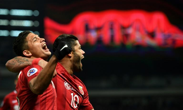 Shanghai SIPG forward Hulk (right) and teammate Elkeson celebrate a goal during their AFC Asian Champions League match against Urawa Red Diamonds in Shanghai on March 15, 2017