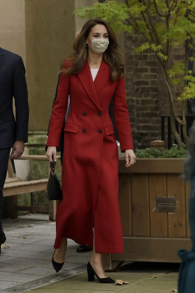 """<p>While visiting St. Bartholomew's Hospital with Prince William, Kate chose a striking red, double-breasted overcoat from the Duchess-approved brand, Alexander McQueen. The Duchess was at the hospital to <a href=""""https://www.townandcountrymag.com/society/tradition/a34425134/kate-middleton-red-coat-alexander-mcqueen-hold-still-photo/"""" target=""""_blank"""">launch her <em>Hold Still</em> photo show</a>, which she worked on for much of lockdown. </p>"""