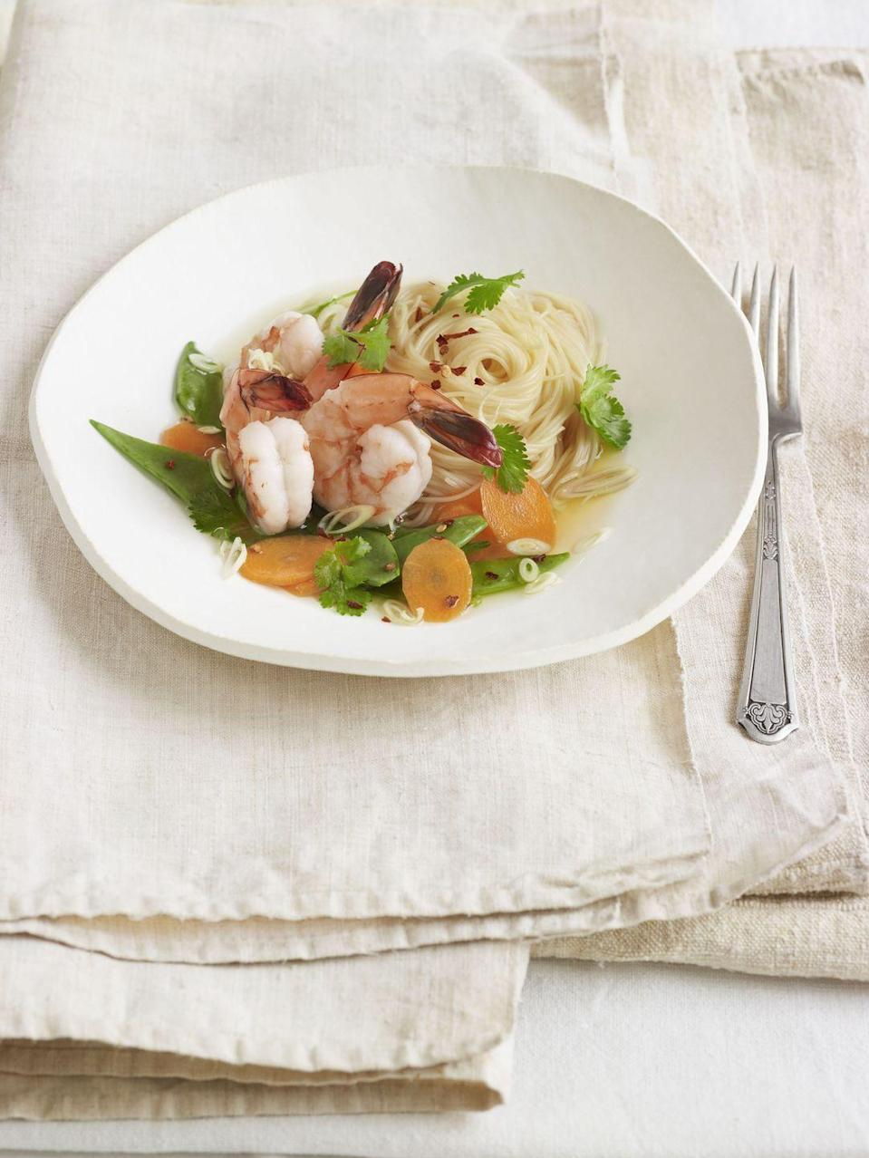 """<p>Plate this fortifying, Thai-inspired seafood dish in shallow bowls with a ladle of aromatic broth and a sprinkle of crushed red pepper. </p><p><strong><a href=""""https://www.countryliving.com/food-drinks/recipes/a4137/capellini-shrimp-lemongrass-ginger-broth-recipe-clv0512/"""" rel=""""nofollow noopener"""" target=""""_blank"""" data-ylk=""""slk:Get the recipe."""" class=""""link rapid-noclick-resp"""">Get the recipe.</a></strong></p>"""