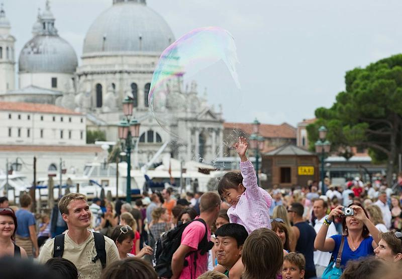 Tourists congregate in St. Marks Square in Venice, where the municipality is starting a levy in September on day-tripping visitors. ( | Marco Secchi—Getty Images.)