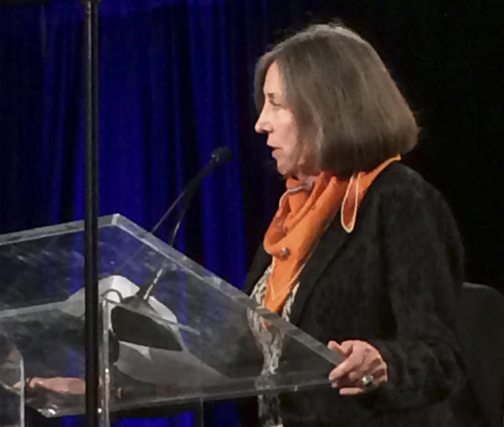 In this Aug. 9, 2014 photo provided by George Lewis, former NBC news reporter and Latina journalism pioneer Cecilia Alvear, who was a founding member of the National Association of Hispanic Journalists, addresses the NAHJ convention in San Antonio, Texas. Alvear died on Friday, April 21, 2017, at home in Santa Monica, Calif. She was 77. (George Lewis via AP)