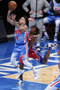 Brooklyn Nets' Chris Chiozza, left, drives past Philadelphia 76ers' Tyrese Maxey during the first half of an NBA basketball game Thursday, Jan. 7, 2021, in New York. (AP Photo/Frank Franklin II)