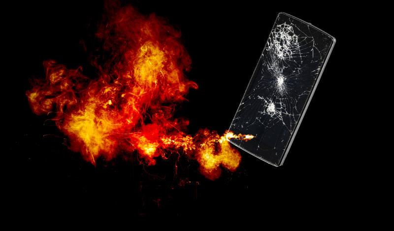 Mobile phone with broken glass exploding.