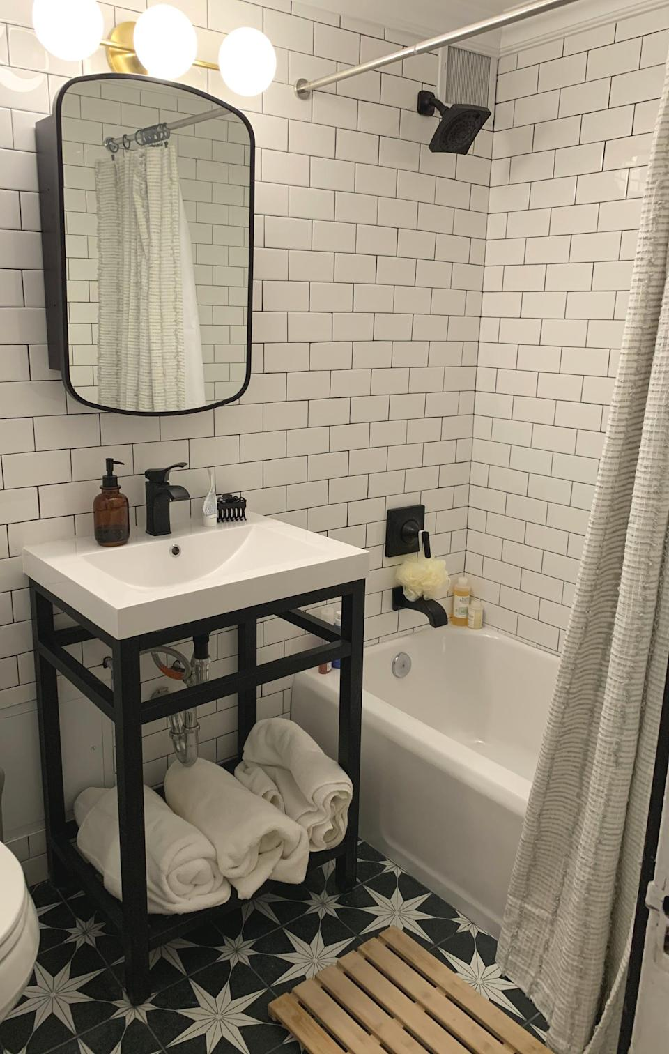 <p>We totally redid our bathroom, and it's now one of my favorite rooms in the house. Swapping silver hardwares for matte black finish and adding a graphic floor tile made a major difference in the overall feel. </p>