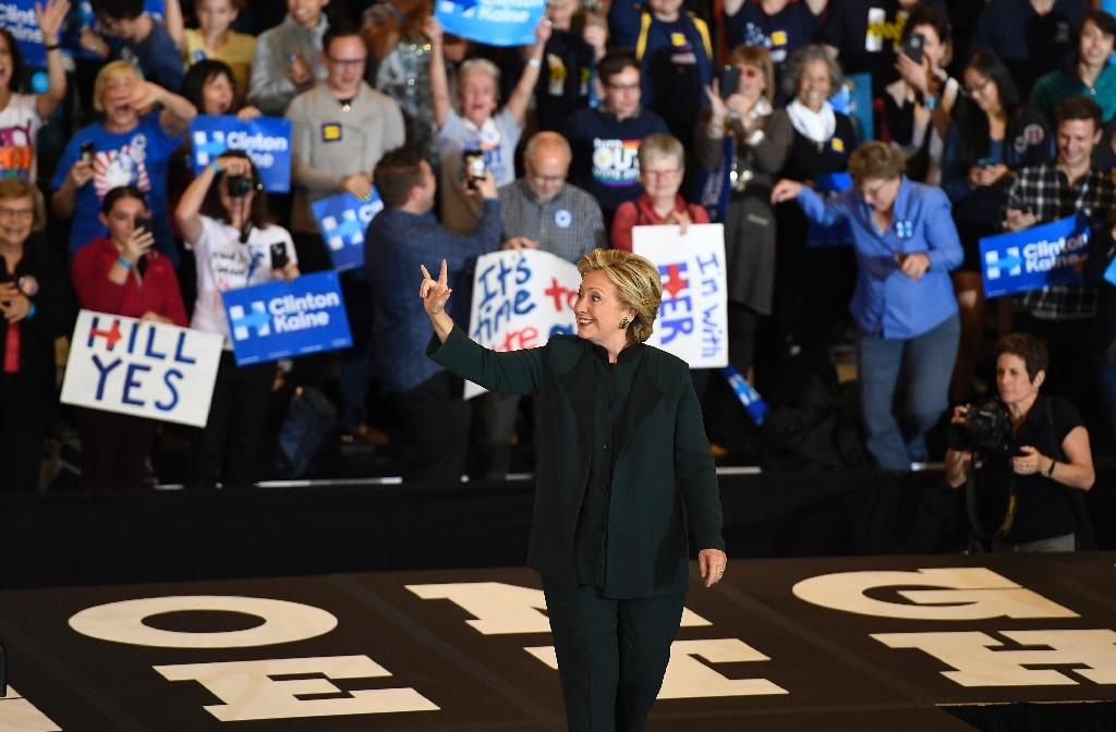 Clinton holds leads in several battleground states, ranging from razor-thin, such as in North Carolina, to moderate in Florida and Pennsylvania and commanding in Virginia (AFP Photo/Robyn Beck)