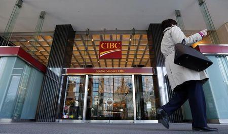 A pedestrian walks past a main branch of CIBC in  Montreal