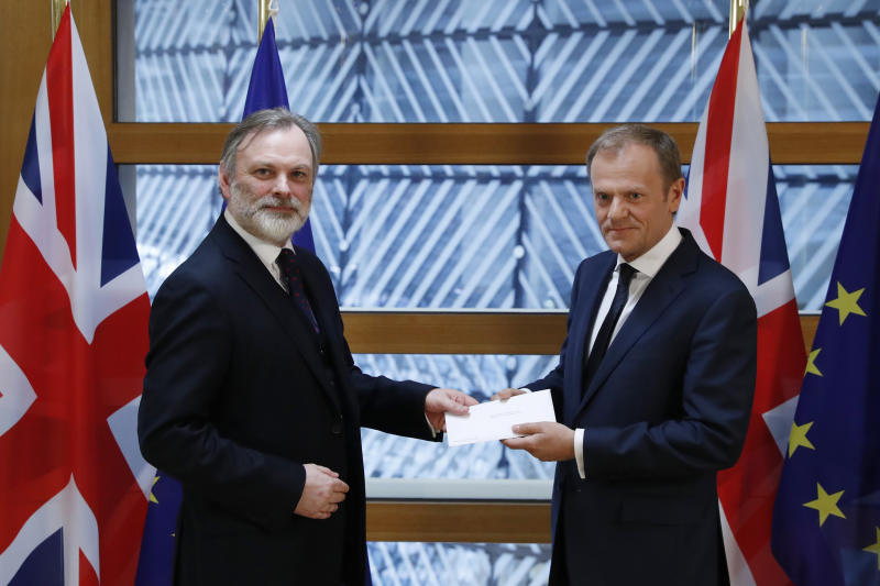 <p> Britain's permanent representative to the European Union Tim Barrow, left, hand delivers British Prime Minister Theresa May's Brexit letter in notice of the UK's intention to leave the bloc under Article 50 of the EU's Lisbon Treaty to EU Council President Donald Tusk, in Brussels, Belgium, Wednesday, March 29, 2017. Barrow hand-delivered the letter signed by Britain's Prime Minister Theresa May that will formally trigger the beginning of Britain's exit from the European Union. (Yves Herman/Pool Photo via AP)