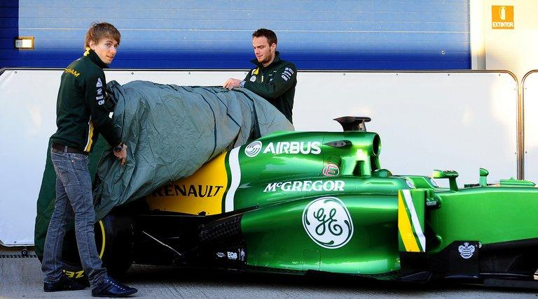 Caterham drivers Giedo van der Garde (right) and Charles Pic unveil the team's new car in Jerez on February 5, 2013