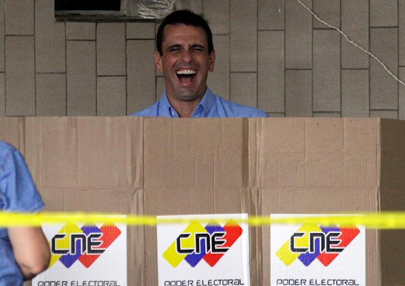 Miranda State's Gov. Henrique Capriles laughs while casting his ballot at a polling station in Caracas, Venezuela, Sunday, Dec. 16, 2012. Venezuelans are choosing governors and state lawmakers  in elections that have become a key test of whether President Hugo Chavez's movement can endure if the socialist leader leaves the political stage. The vote is the first time in Chavez's nearly 14-year-old presidency that he has been unable to actively campaign. He hasn't spoken publicly since undergoing cancer surgery on Tuesday in Cuba. (AP Photo/Fernando Llano)