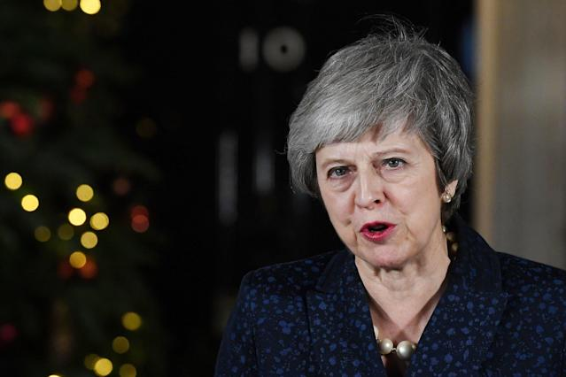 Theresa May gives a statement outside No10 after surviving a confidence vote in her leadership: EPA