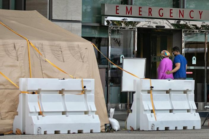 LOS ANGELES, CA - JANUARY 10: People enter UCLA Medical Center in Westwood, were there are tents outside the ER to triage and treat the overflow of patients on Sunday, Jan. 10, 2021 in Los Angeles, CA. (Jason Armond / Los Angeles Times)