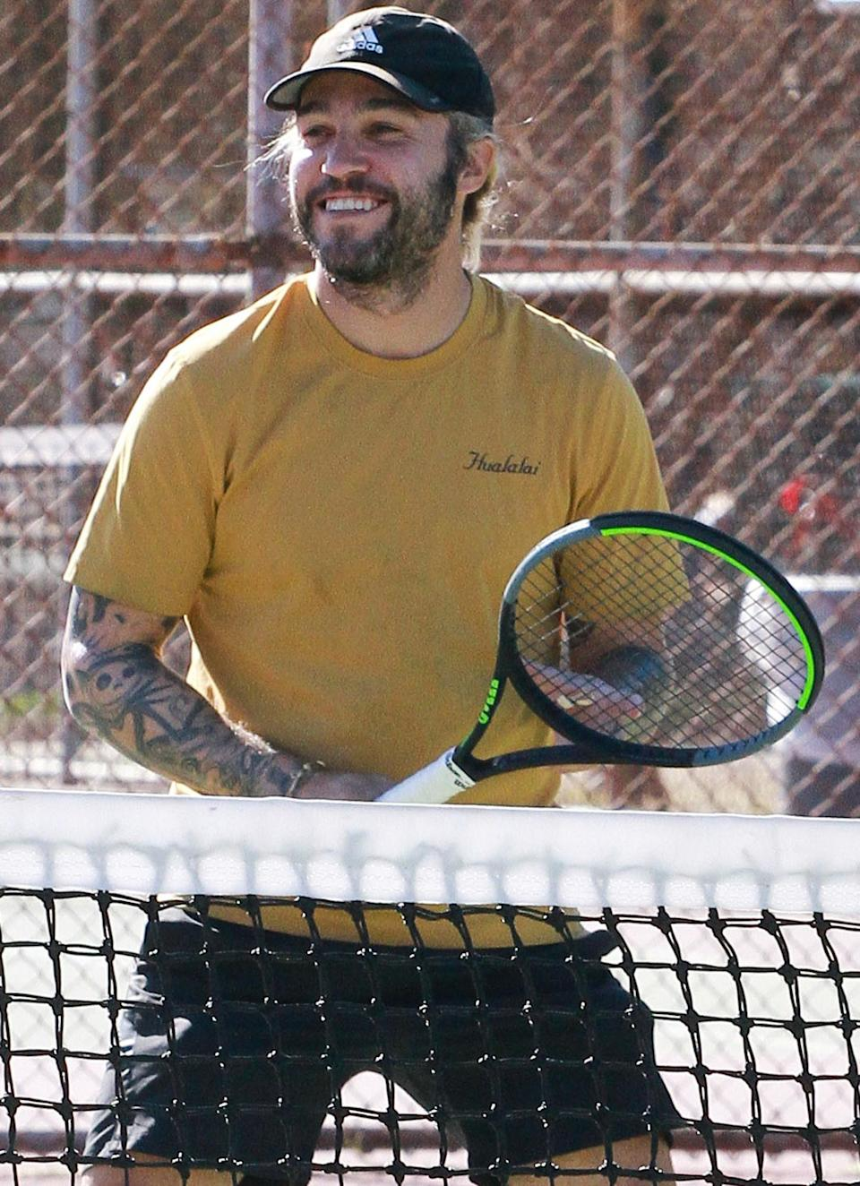 <p>Pete Wentz is in great spirits while playing tennis on Monday in L.A.</p>