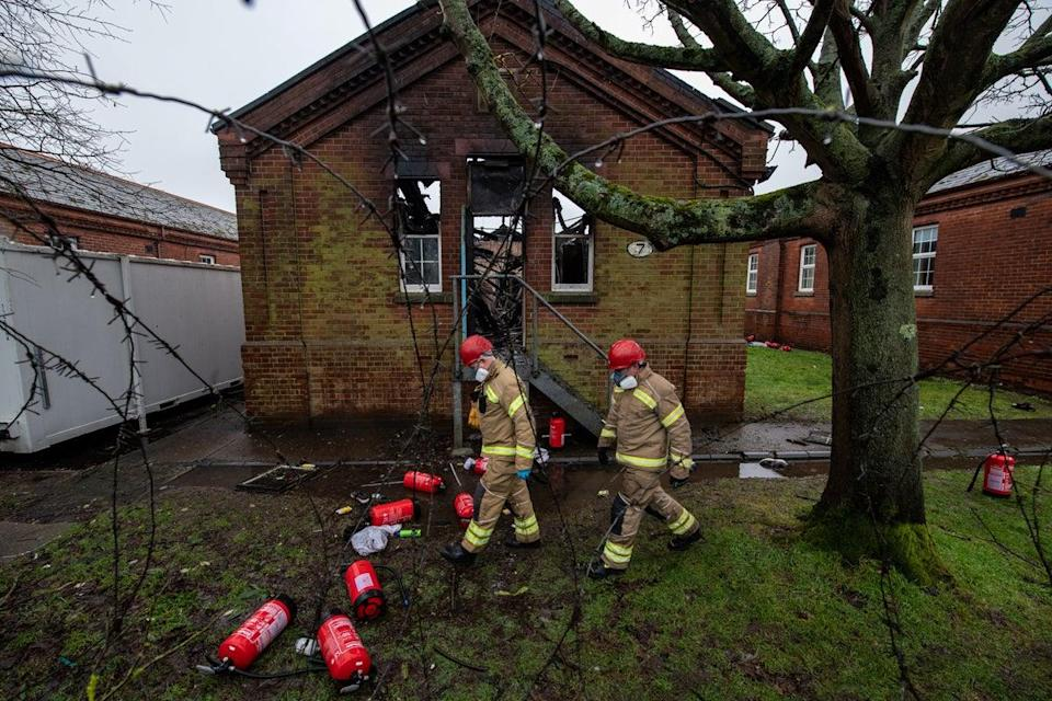 <p>A fire broke out at Napier Barracks on 29 January, months after inspectors found residents were at 'significant risk' due to a lack of fire safety measures</p> (Getty)