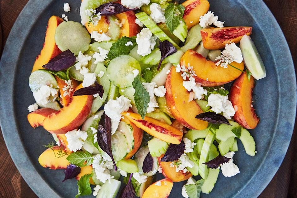 """This sweet salad is one one of the most colorful cucumber recipes we've come across. Look for ripe, yellow peaches, heirloom cucumbers, and English hothouse cucumbers when you gather up the produce for this savory-sweet salad. <a href=""""https://www.epicurious.com/recipes/food/views/cucumber-and-peach-salad-with-herbs?mbid=synd_yahoo_rss"""" rel=""""nofollow noopener"""" target=""""_blank"""" data-ylk=""""slk:See recipe."""" class=""""link rapid-noclick-resp"""">See recipe.</a>"""
