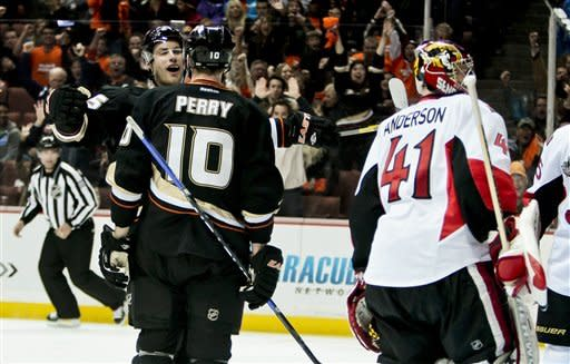 Anaheim Ducks right wing Corey Perry (10) celebrates scoring with center Ryan Getzlaf during the second period of an NHL hockey game against the Ottawa Senators, Saturday, Jan. 21, 2012, in Anaheim, Calif. (AP Photo/Bret Hartman)