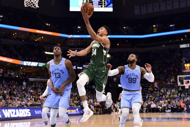 Milwaukee Bucks forward Giannis Antetokounmpo (34) shoots between Memphis Grizzlies forwards Jaren Jackson Jr. (13) and Jae Crowder (99) in the second half of an NBA basketball game Friday, Dec. 13, 2019, in Memphis, Tenn. (AP Photo/Brandon Dill)