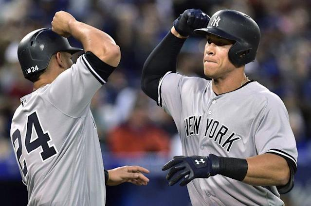 Aaron Judge (right) celebrates another mammoth home run with Yankees teammate Gary Sanchez. (AP)
