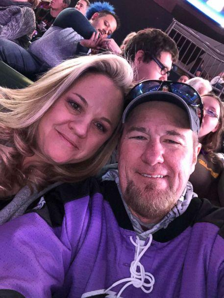 PHOTO: Keith Alexander, 55, and his wife are seen smiling at a hockey game on Jan. 19. The father of four had recently undergone surgery to remove a mass on his colon and will be going under the knife again to remove lesions on his liver.  (Keith Alexander)