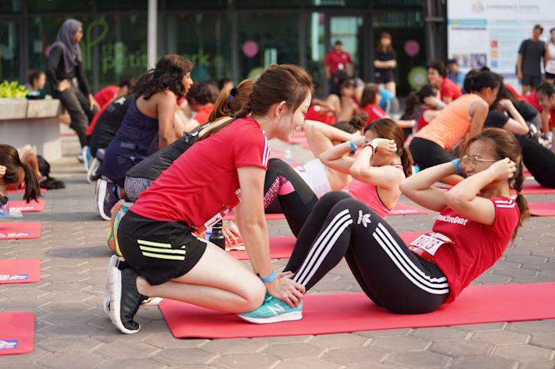 Participants of the Great Eastern Women's IPPT event doing sit-ups. (PHOTO: Great Eastern Women's Run)